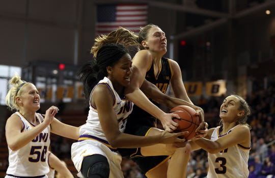 Iowa Hawkeyes forward Amanda Ollinger (43) battles for a rebound against Northern Iowa's Bre Gunnels (11) Sunday, November 17, 2019 at the McLeod Center.