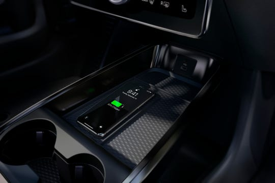 Inside Mustang Mach-E, a wireless charging pad makes it easier to cut the cord with compatible smartphones.