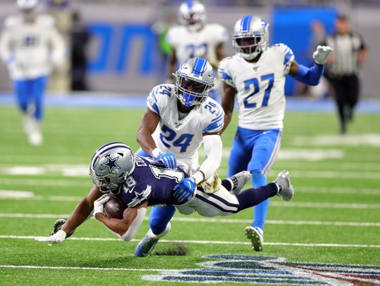 Lions cornerback Amani Oruwariye tackles Cowboys wide receiver Randall Cobb during the second half of the Lions' 35-27 loss on Sunday, Nov. 17, 2019, at Ford Field.