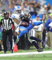 Kenny Golladay is defended by Anthony Brown during the first half.