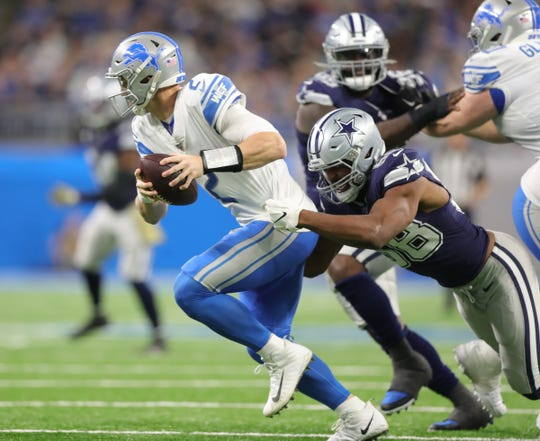 Lions quarterback Jeff Driskel is sacked by Cowboys defensive tackle Tyrone Crawford during the first half on Sunday, Nov. 17, 2019, at Ford Field.