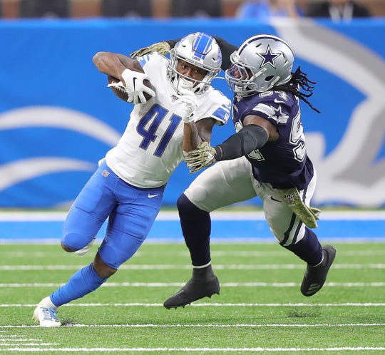 Lions running back J.D. McKissic is tackled by Cowboys middle linebacker Jaylon Smith during the second half of the Lions' 35-27 loss on Sunday, Nov. 17, 2019, at Ford Field.