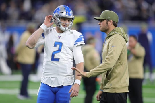 Lions quarterbacks Matthew Stafford, right, and Jeff Driskel talk before the game against the Dallas Cowboys on Sunday, Nov. 17, 2019, at Ford Field.