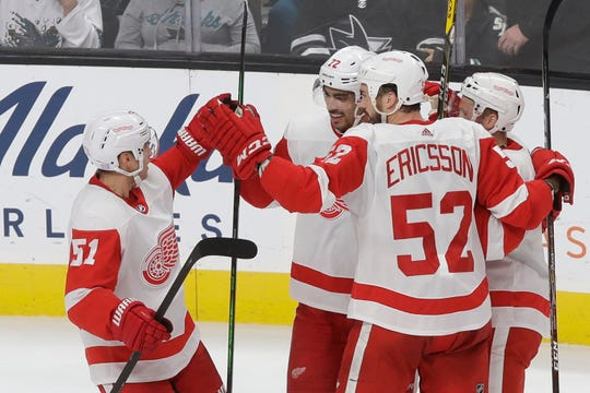 Red Wings center Andreas Athanasiou, middle, is congratulated by teammates after scoring a goal against the Sharks during the third period of the Wings' 4-3 loss in San Jose, California, on Saturday, Nov. 16, 2019.