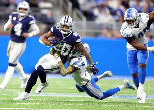 Tracy Walker tackles Cowboys running back Tony Pollard during the first half Sunday at Ford Field.
