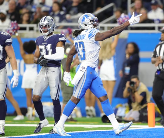 Lions running back Bo Scarbrough signals first down during the first half of the Lions' 35-27 loss on Sunday, Nov. 17, 2019, at Ford Field.