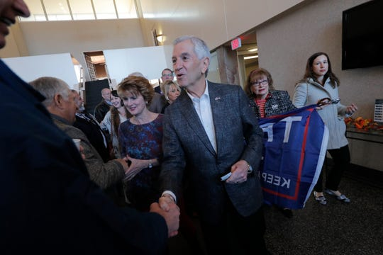 Eddie Rispone greets supporters at a campaign stop in Shreveport, La., Friday, Nov. 15, 2019.