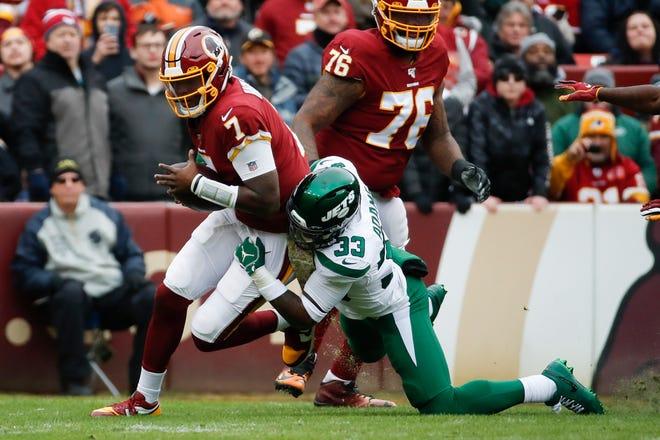 Jets safety Jamal Adams (33) sacks Washington quarterback Dwayne Haskins (7) in the first half on Sunday.