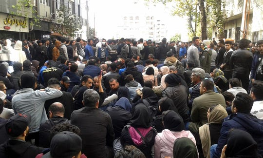 Protesters angered by Iran raising government-set gasoline prices by 50% blocked traffic in major cities and occasionally clashed with police Saturday after a night of demonstrations punctuated by gunfire.