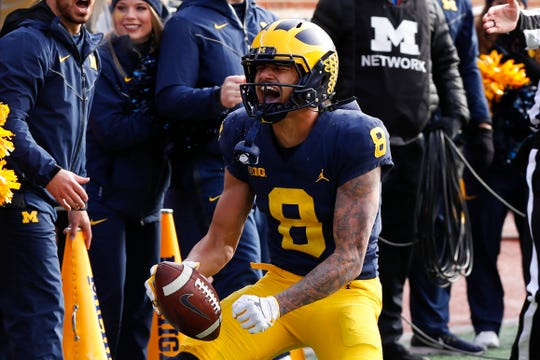 Michigan wide receiver Ronnie Bell (8) reacts after a reception against Michigan State in the first half on Saturday.