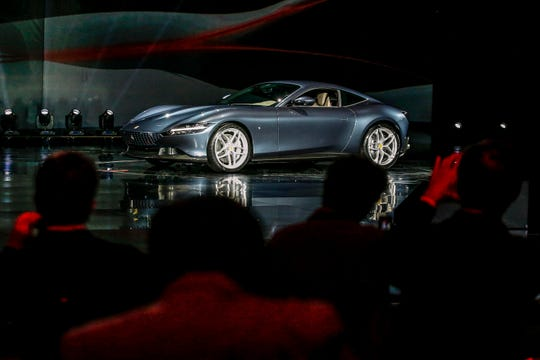 The Ferrari Roma car is unveiled in Rome, Thursday, Nov. 14, 2019.
