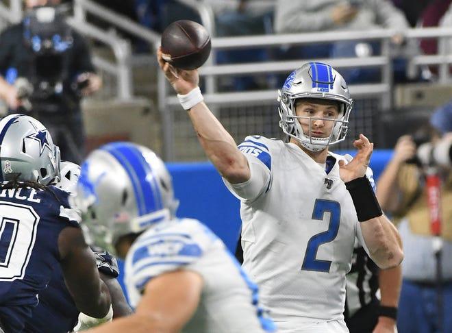 Lions quarterback Jeff Driskel throws under pressure in the second quarter.
