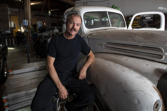 """Greg """"Reverend Gadget"""" Abbott, car inventor and EV whiz, in his shop in Los Angeles."""