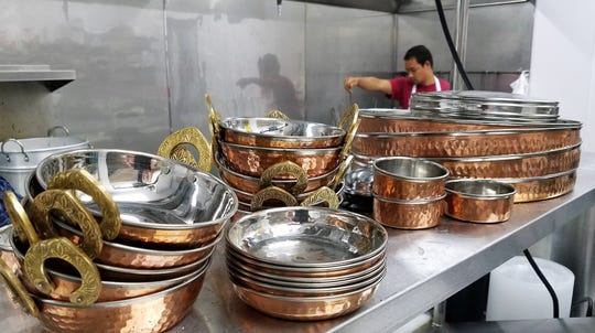 Nepali thali and copper serving dishes at Yak & Yeti Himalayan Cuisine.