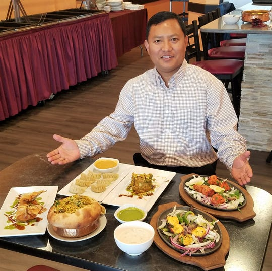 Sagar Tamang of Yak & Yeti Himalayan Cuisine with a selection of the house specialties.