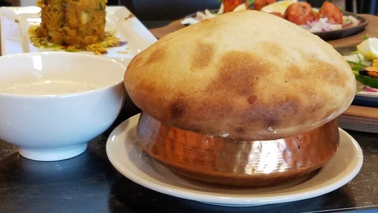"Dum biryani is a rice dish baked in a copper pot with a ""lid"" of bread to hold in the steam and aroma."