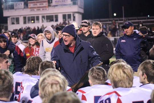 Todd Wilkerson talks to his Heritage Hills Patriots team after their 22-0 win over Lawrenceburg in the Class 3A regional.