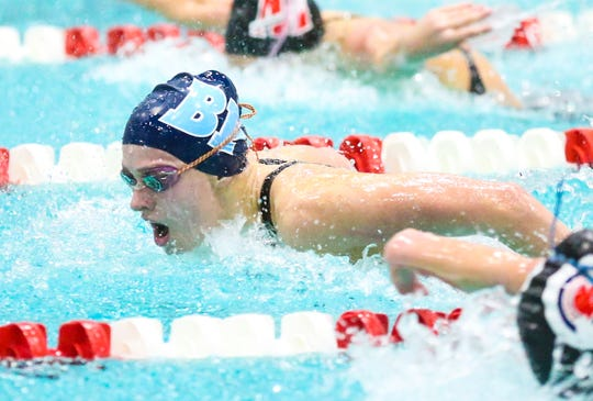Bay Port High School's Emma Lasecki swims in the 100-yard butterfly Saturday, November 16, 2019, in the girls Division 1 WIAA state swimming meet in Madison, Wis.
