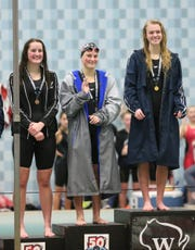 Green Bay Southwest Co-op High School's Brigitta Neverman (left) and Bay Port High School's Emma Lasecki (right) take third and first place in the 200-yard individual medley Saturday, November 16, 2019, in the girls Division 1 WIAA state swimming meet in Madison, Wis.