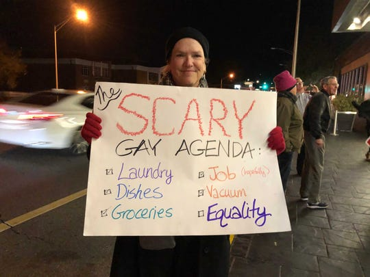 Marion Banzhaf holds a sign at a protest outside Hotel Duval. Marion Banzhaf holds a sign at a protest  Tuesday evening, Nov. 13, 2019, outside Hotel Duval.