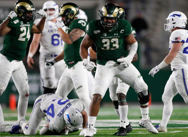 Colorado State defensive end Emmanuel Jones, right, reacts after stopping Air Force running back Kadin Remsberg for a short gain in the second half of an NCAA football game Saturday, Nov. 16, 2019 in Fort Collins, Colo. Air Force won 38-21.