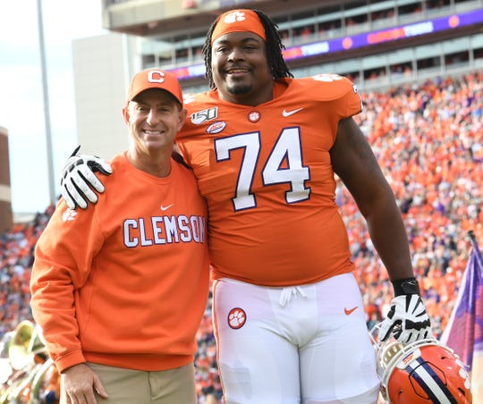 Clemson Head Coach Dabo Swinney and offensive guard John Simpson (74) during senior day ceremonies before the game at Memorial Stadium in Clemson, South Carolina Saturday, November 16, 2019.