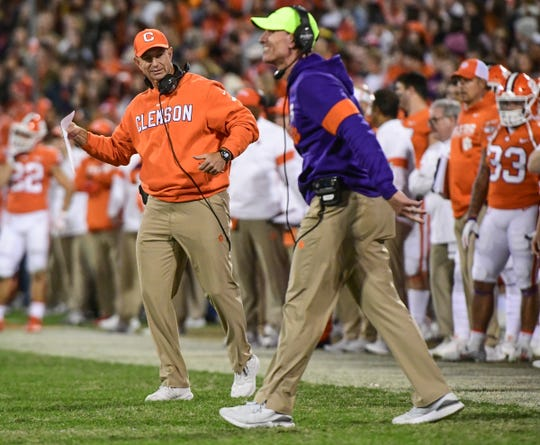 Clemson Defensive Coordinator Brent Venables and head coach Dabo Swinney during the fourth quarter at Memorial Stadium in Clemson, South Carolina Saturday, November 16, 2019.