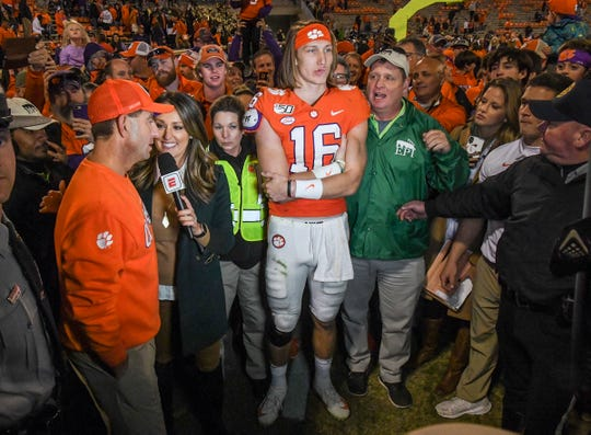 Clemson Head Coach Dabo Swinney is interviewed near quarterback Trevor Lawrence (16) after beating Wake Forest at Memorial Stadium in Clemson Saturday, November 16, 2019.