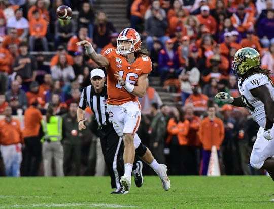 Clemson quarterback Trevor Lawrence (16) passes near Wake Forest linebacker Ja'Cquez Williams(30) during the third quarter at Memorial Stadium in Clemson, South Carolina Saturday, November 16, 2019.