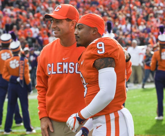 Clemson Head Coach Dabo Swinney and cornerback Brian Dawkins Jr. (9) during senior day ceremonies before the game at Memorial Stadium in Clemson, South Carolina Saturday, November 16, 2019.