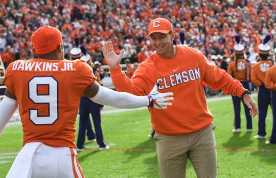 cornerback Brian Dawkins Jr. (9) is greeted by Clemson Head Coach Dabo Swinney during senior day ceremonies before the game at Memorial Stadium in Clemson, South Carolina Saturday, November 16, 2019.