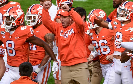 Clemson coach Dabo Swinney and players prepare to face Wake Forest during their game at Memorial Stadium.