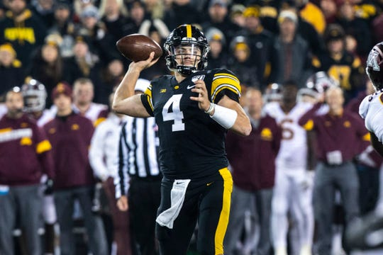 Iowa quarterback Nate Stanley (4) throws a pass during a NCAA Big Ten Conference football game, Saturday, Nov., 16, 2019, at Kinnick Stadium in Iowa City, Iowa.