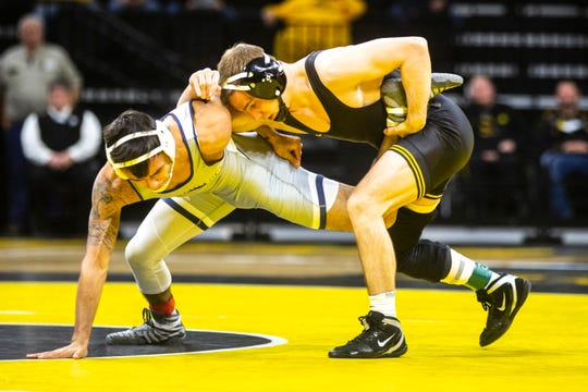 Iowa's Spencer Lee wrestles University of Tennessee-Chattanooga's Fabian Gutierrez at 125 pounds during a NCAA non-conference wrestling dual, Sunday, Nov., 17, 2019, at Carver-Hawkeye Arena in Iowa City, Iowa.