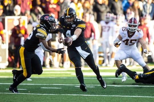 Nate Stanley handing off to Tyler Goodson should be a familiar scene Saturday at Kinnick Stadium.