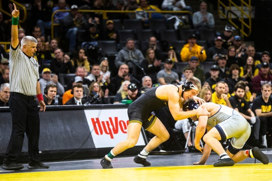 Iowa's Nelson Brands, left, scores an escape against University of Tennessee-Chattanooga's Matthew Waddell at 184 pounds during a NCAA non-conference wrestling dual, Sunday, Nov., 17, 2019, at Carver-Hawkeye Arena in Iowa City, Iowa.