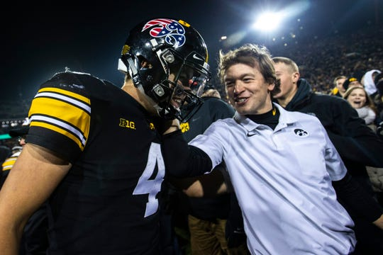 Iowa quarterback Nate Stanley (4) smiles after a NCAA Big Ten Conference football game, Saturday, Nov., 16, 2019, at Kinnick Stadium in Iowa City, Iowa. The Hawkeyes defeated Minnesota, 23-19.