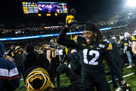 Brandon Smith (12) was able to celebrate Iowa's 23-19 victory against Minnesota after playing just one snap. The junior wide receiver should be a much more prevalent part of Iowa's plans against Illinois.