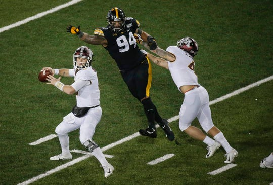 Iowa junior defensive end A.J. Epenesa gets to Minnesota quarterback Tanner Morgan to cause Morgan to fumble the ball in the third quarter at Kinnick Stadium in Iowa City on Saturday, Nov. 16, 2019.