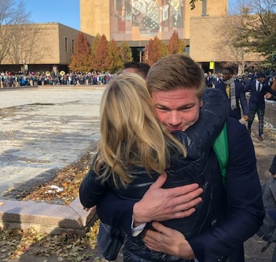 Notre Dame junior linebacker Reed Gregory hugs his mom, Fox News anchor Martha MacCallum, before the team took on Navy Nov. 16.