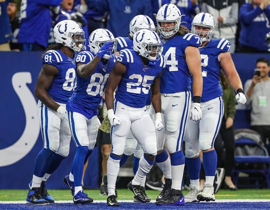 The Indianapolis Colts celebrate a touchdown by running back Marlon Mack (25) during the first quarter of the game against the Jacksonville Jaguars at Lucas Oil Stadium in Indianapolis, Sunday, Nov. 17, 2019.
