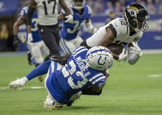 Kenny Moore II of the Indianapolis Colts tackles Dede Westbrook of the Jacksonville Jaguars, Jacksonville Jaguars at Indianapolis Colts, Lucas Oil Stadium, Indianapolis, Nov. 17, 2019.