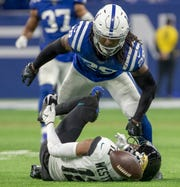 Malik Hooker of the Indianapolis Colts looks over Dede Westbrook of the Jacksonville Jaguars after the Colts defender dropped him with a huge second half tackle, Jacksonville Jaguars at Indianapolis Colts, Lucas Oil Stadium, Indianapolis, Nov. 17, 2019.  Colts won 33-13.