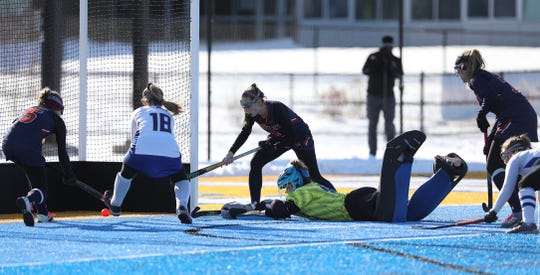 Grace Arrese scores Horace Greeley's lone goal after hitting the ball past Maine-Endwell goalie Amanda Spak. Trying to help Arrese is teammate Isabelle Klein while Maine-Endwell's Meredith Rose doesn't reach the ball in time.