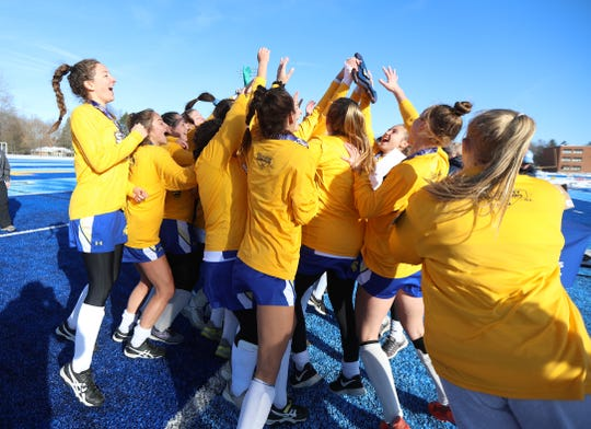 Maine-Endwell celebrates after winning the state Class A field hockey championship.
