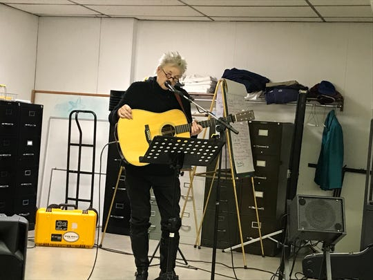 """Knoxville songwriter Maggie Longmire performs """"Kingston 2008,"""" her song honoring Kingston coal ash disaster workers, at a Jobs With Justice event Nov. 16, 2019."""