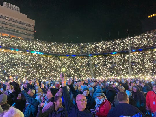Fans hold up their phone lights at the Garth Brooks concert at Neyland Stadium.