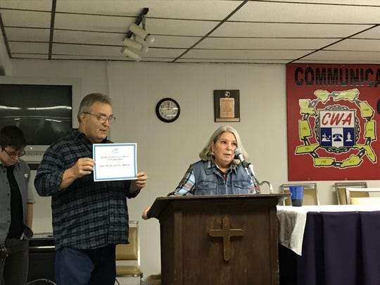 Janie Clark, right, wife of Kingston coal ash disaster worker Ansol Clark, left, speaks at a Jobs with Justice event Nov. 16, 2019.