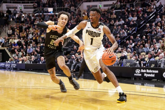Purdue forward Aaron Wheeler (1) drives on Chicago State forward Jace Colley (23) during the second half of an NCAA college basketball game in West Lafayette, Ind., Saturday, Nov. 16, 2019. Purdue defeated Chicago State 93-49. (AP Photo/Michael Conroy)