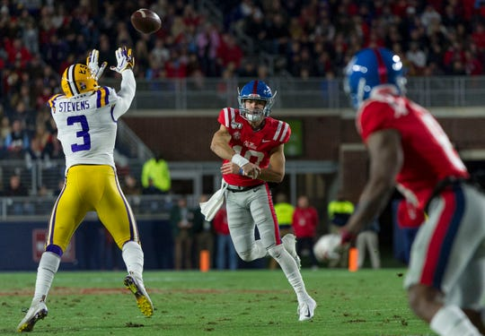 Nov 16, 2019; Oxford, MS, USA; Mississippi Rebels quarterback John Rhys Plumlee (10) passes against LSU Tigers safety JaCoby Stevens (3) during the first half at Vaught-Hemingway Stadium. Mandatory Credit: Justin Ford-USA TODAY Sports